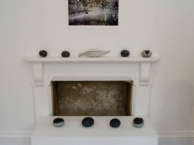 Image shows ceramics displayed on a mantelpiece