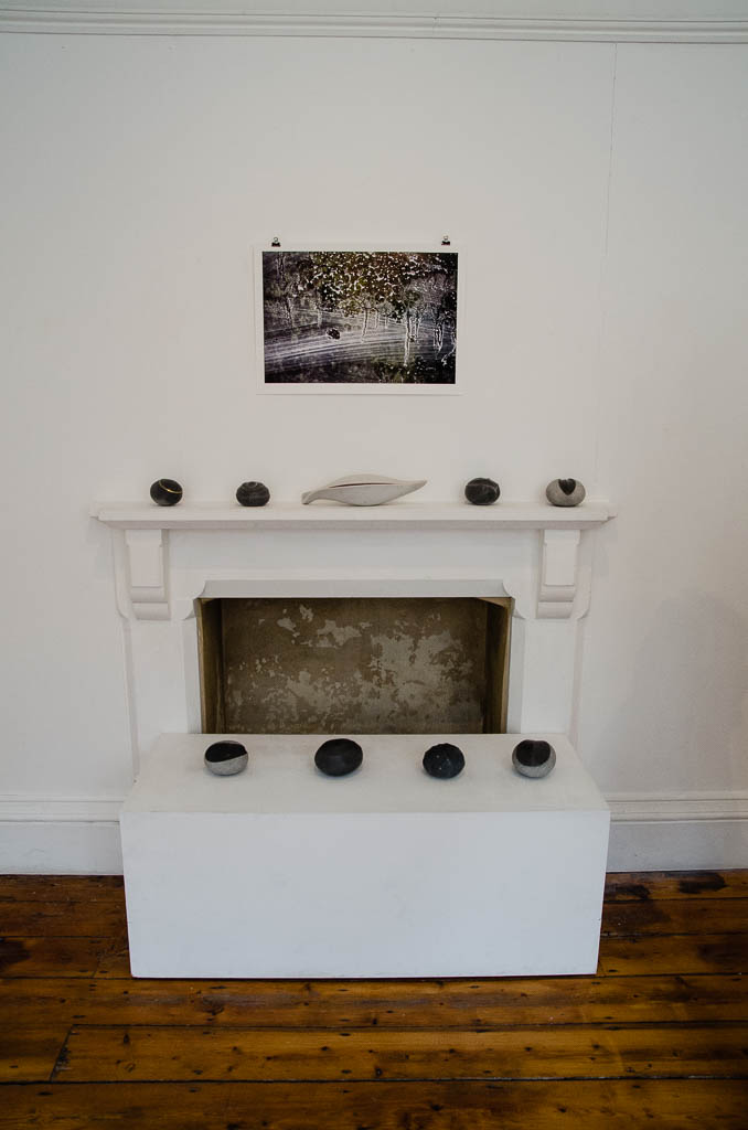 Image shows ceramics displayed on a mantelpiece
