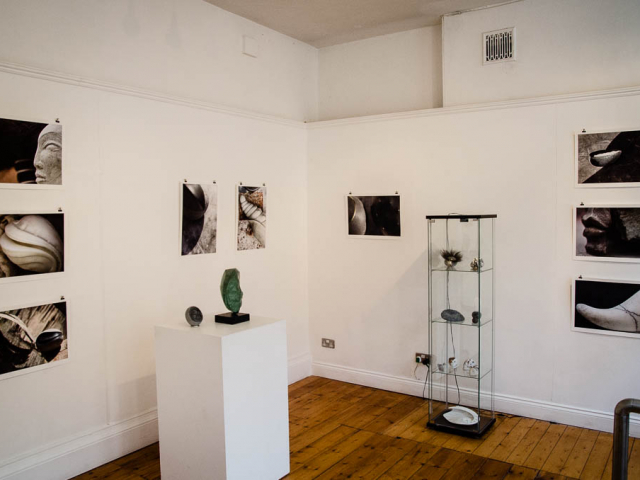 Image shows various ceramics displayed in lansdown gallery, as well as photos of sculptures