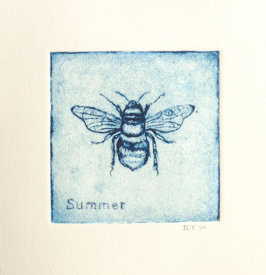 "A blue print of a bee from above, detailed and up close, with the word ""Summer"" in the bottom left cornet"