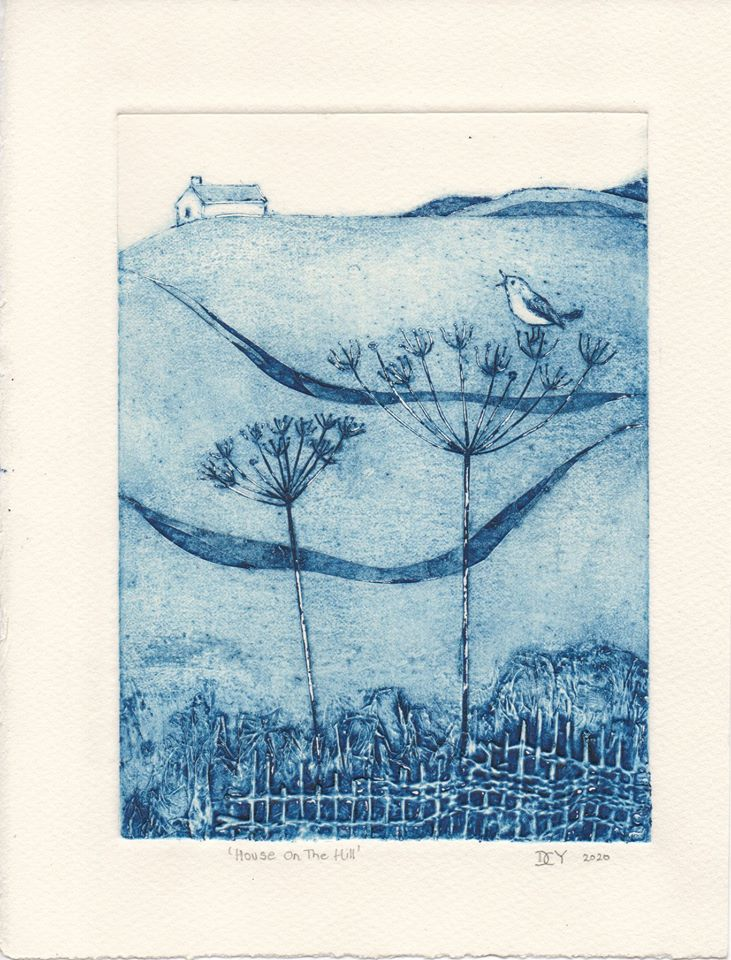 A blue toned print of a landscape. In the background, a small house on a hill with escarpements. In the foreground a fence, a plant, a bird singing.