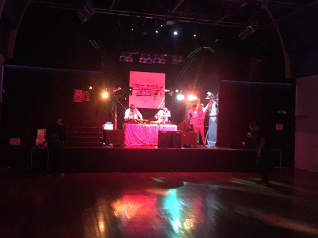 Image shows DJs setting up a sound system